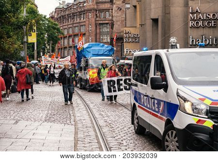 STRASBOURG FRANCE - SEPT 12 2017: Demonstrators with Resistance banner at political march during a French Nationwide day of protest against the labor reform proposed by Emmanuel Macron Government