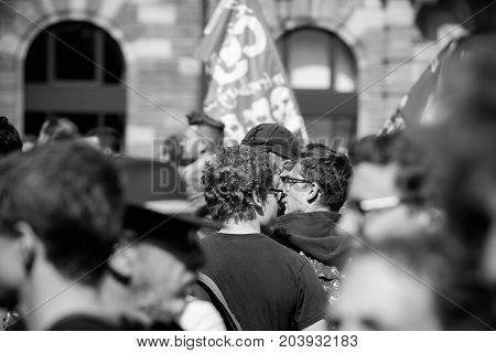 STRASBOURG FRANCE - SEPT 12 2017: Black and white demonstrators walk at political march during a French Nationwide day of protest against the labor reform proposed by Emmanuel Macron Government