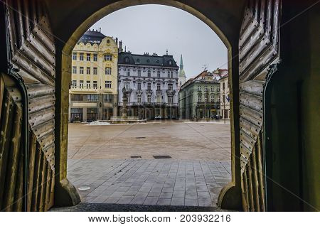 Historical center of Bratislava you can see the old town hall's gates the main square the fountain of Maximilian and a sculpture of Napoleon leaning on a bench and the dome of St. Martin Cathedral