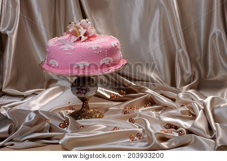 Sweet cake decorated with fondant on a plate
