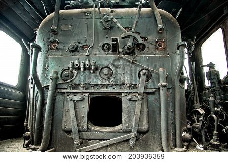 Old abandoned rusty steam locomotive train interior