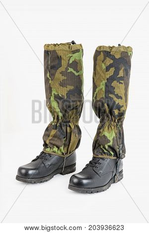 Military boots with sleeves Shoe covers for boots. Protective sleeve against the snow above the boot
