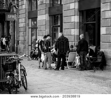 STRASBOURG FRANCE - SEP 9 2014: Customers waiting outside Apple Store prior the launch day of the newest iPhone Apple Watch iPad iMac computers - large Apple Store facade with computer Apple logotype