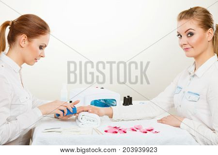 Beautician With Client At Beauty Salon.