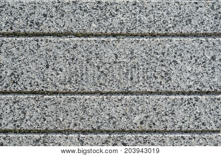 Gray Granite Texture with Parallel Decorative Grooves. Natural Stone as a Wall Finishing Material