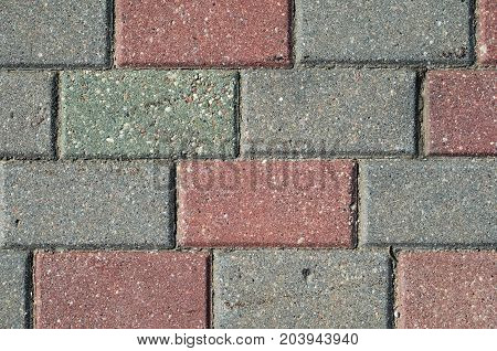 Red and gray paving stones texture. Paving stone background