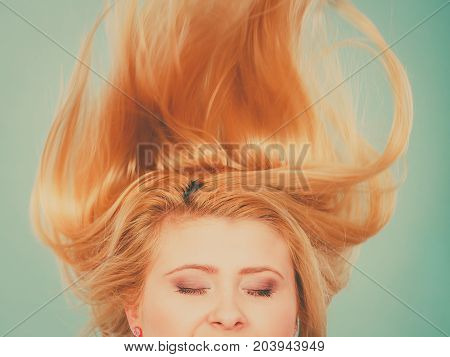 Woman With Closed Eyes And Windblown Hair