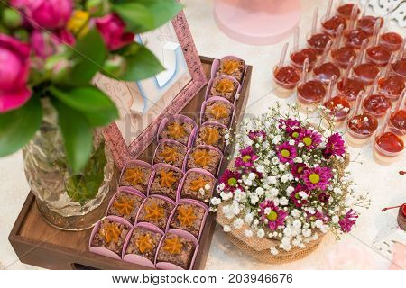 Horizontal picture of letter L in a picture frames and milk candy dessert for woman party