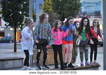 Girls With Hallowen Dress Standing In A Beanch ,eire Square, Galway, Ireland September 2017