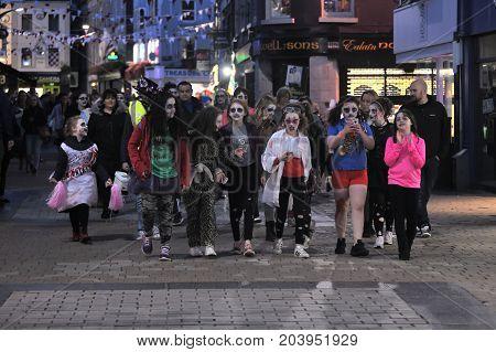 Zombie Walk Shop Street, Big Croud Of People With Zombie Dress Walking By The Street, Girls In The F