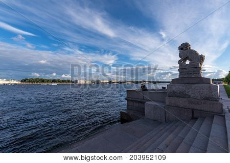 SY.PETERSBURG/RUSSIA - JULY 20, 2017. Granite sculpture of the mythological lion guard Shi-Tzu on the embankment of St. Petersburg