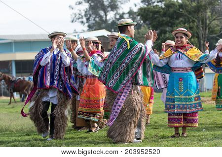 May 27 2017 Sangolqui Ecuador: indigenous quechua people in colourful traditional costumes performing dances as opening of a rural rodeo event