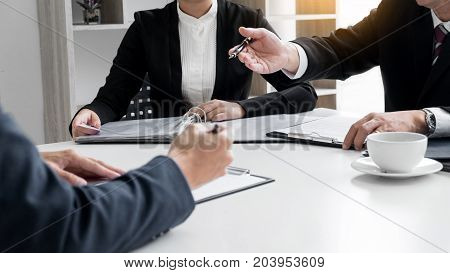 Businessman conducting an interview with businessman in an office.