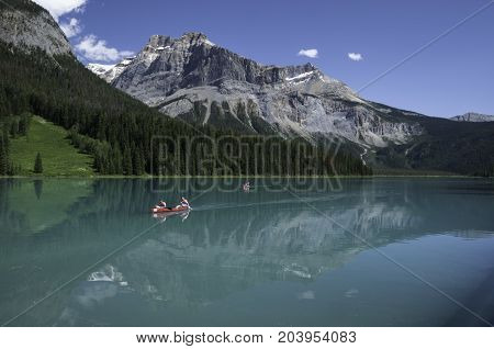 Emerald Lake in Yoho National Park British Columbia Canada with red canoes