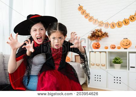 Mother And Her Cute Girl Use Horror Face