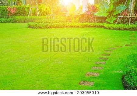 The official front landscaping is a beautifully designed garden. The morning sun shines in front of the house.