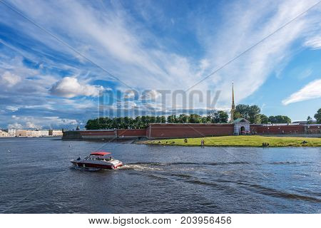 ST.PETERSBURG/RUSSIA - JULY 20, 2017. A pleasure boat with tourists sails near the Peter and Paul Fortress