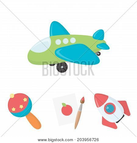 A sheet of paper with an apple pattern, a paint brush, a flying rocket with a porthole, a rattle for a child, an airplane with a chassis and a porthole. Toys set collection icons in cartoon style vector symbol stock illustration .
