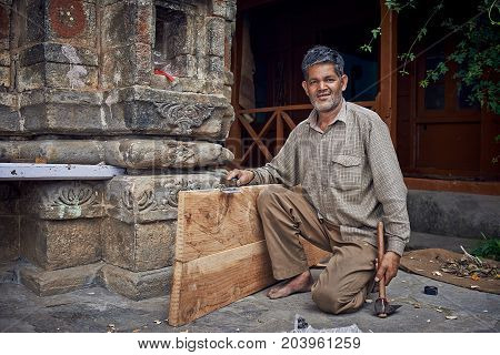 Naggar, India - July 17: Indian Carpenter Made A New Door. Posing For Photography. July 17, 2013 In