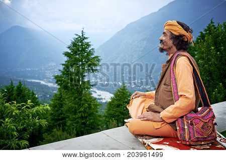 Naggar, India - July 17: Indian Brahmin Looks Down From Himalaya Mountains To The Valley Kullu. July