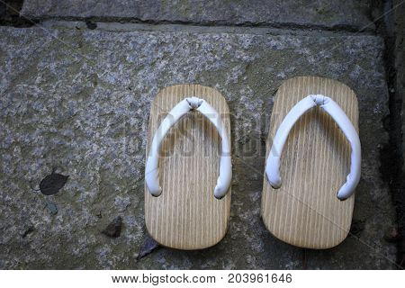 A pair of Japanese clogs on flagging