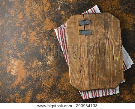 Vintage cutting board on a brown background