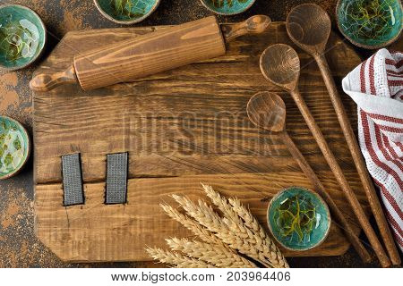 Vintage utensils on a brown background baking concept