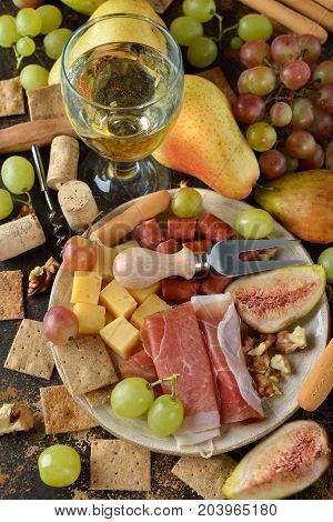 Wine and snacks on a brown background