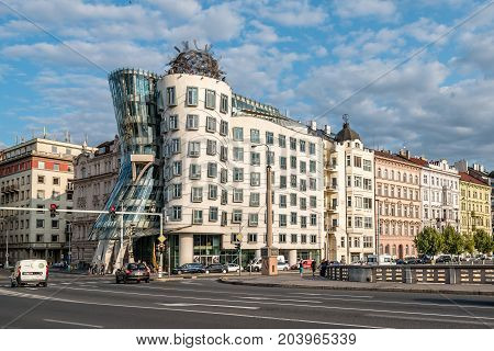 Prague, Czech Republic - August 21, 2017: Dancing House building in Prague, also known as Fred and Ginger. It is building in Prague riverfront designed by Frank Gehry architect. Sunny day of summer
