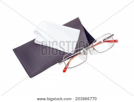 Modern pair of the classic men's eyeglasses in metal frame and soft spectacle-case with white wipes for glasses beside on a white background