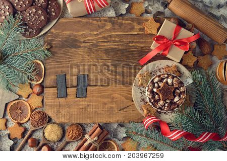 Christmas sweets and decorations on a brown background