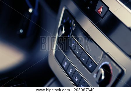 Car inside driver place. Interior of prestige modern car. Steering wheel dashboard display climate control
