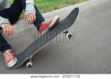 Unrecognizable skateboarder ready to next step of competition, olly trick exercise. Extreme sport challenge and training, skateboarding urban lifestyle and culture