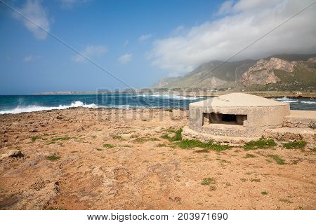 An old remnant of a bunker of the war WWII on the coast of Sicily in the Gulf of Macari near San Vito lo Capo in the Trapani province