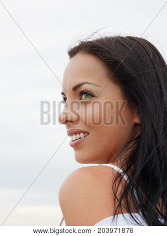 Beautiful green-eyed mulatto girl portrait, smiling outdoors