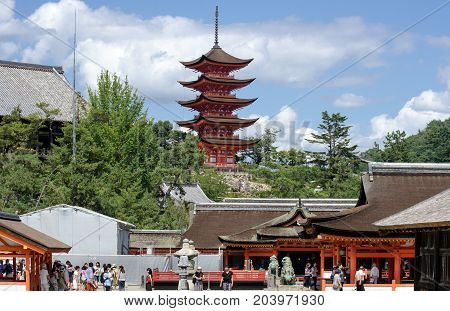Torists And Five-storied Pagoda (gojunoto) At Miyajima Island. Japan
