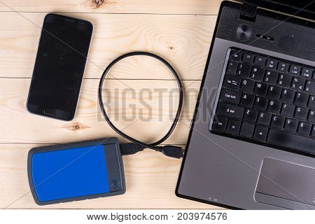 Flat Lay Above Lap Top Computer Keyboard With External Usb Hard Disc Hdd And Mobile Phone