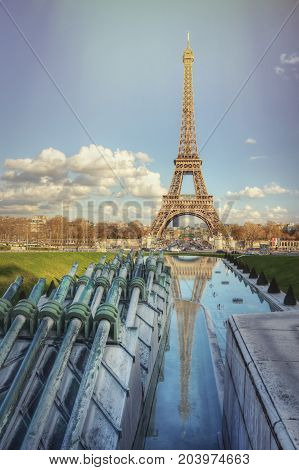 The Eiffel Tower and fountains on a sunny spring day. Paris. France