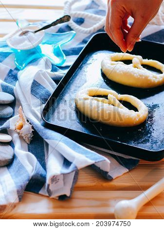 The process of cooking traditional German baked goods pretzels with sea salt raw pastries. Sea style. Oktoberfest.