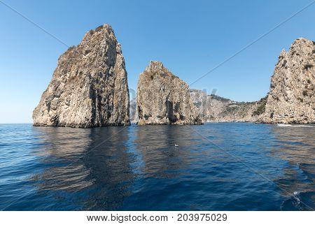 Faraglioni Rocks on Capri Island Italy. Rock's names left to left: Stella Mezzo and Scopolo or Fuori