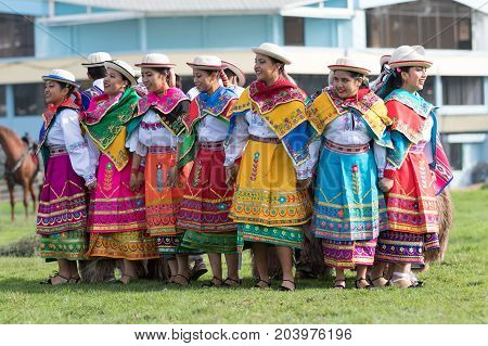 May 27 2017 Sangolqui Ecuador: indigenous quechua women in colourful traditional costumes performing dances as opening of a rural rodeo event