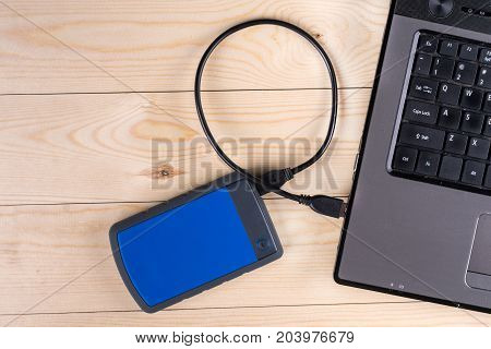 Flat Lay Above Lap Top Computer Keyboard And External Hard Disc With Copy Space