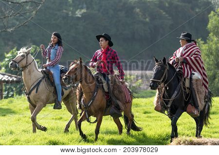 May 27 2017 Sangolqui Ecuador: cowboys taking a horseback ride outdoors in the high Andes during a rural rodeo