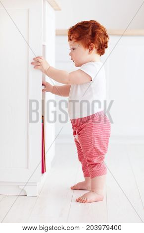 Curious Redhead Baby Boy Discovering The Bright Room