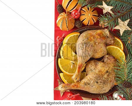 Christmas duck with oranges on a white background