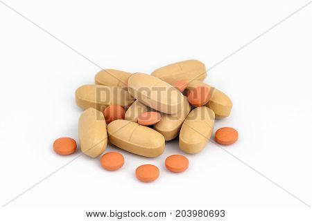 pills stacked isolated on white. Healthcare background.