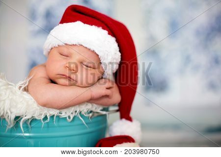 Portrait Of A Newborn Baby Boy,l Wearing Christmas Hat, Sleeping