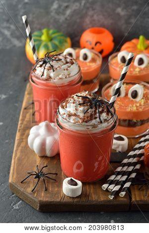Pumpkin milkshake with whipped cream for Halloween