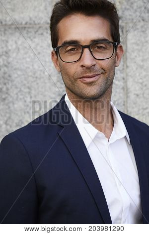 Smiling businessman in suit and glasses portrait