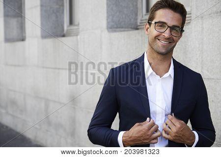 Handsome Sharp suited businessman in glasses portrait
